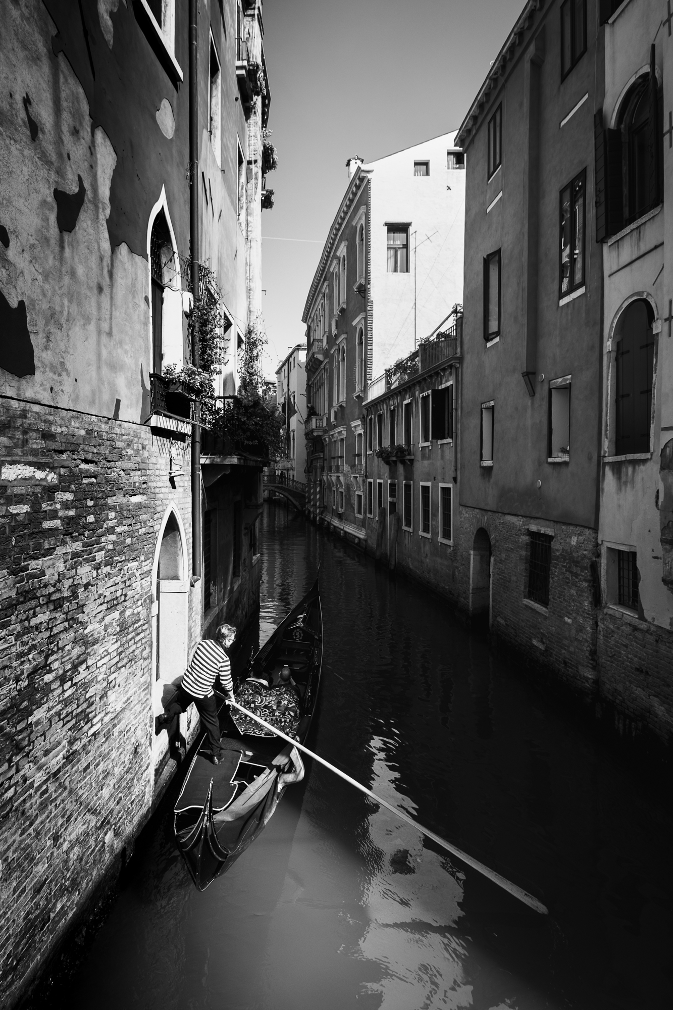 A photo of a Gondolier on the canal in Venice taken by Trevor Sherwin