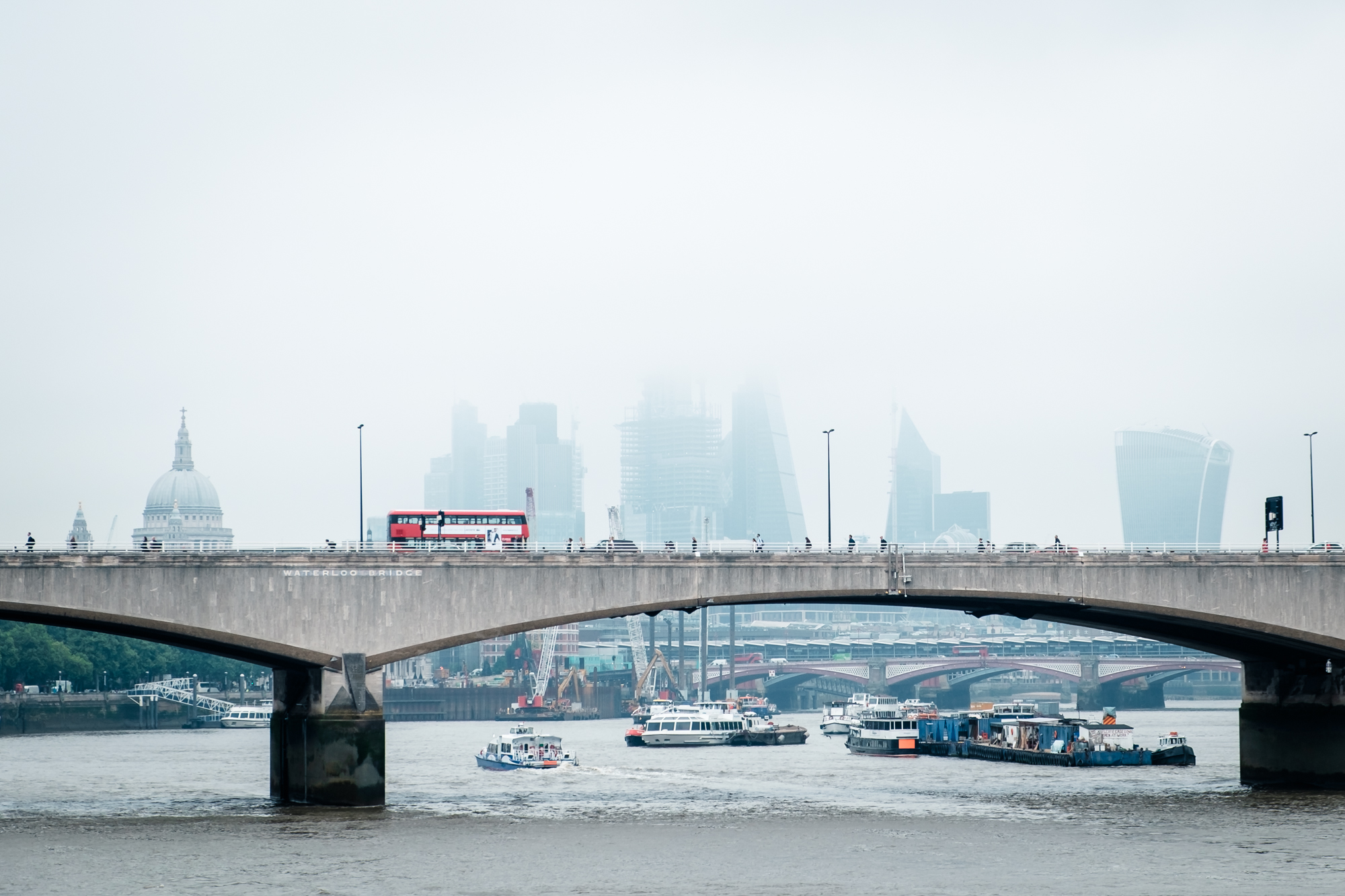 Cityscape photo of Waterloo Bridge, London in the fog by Trevor Sherwin