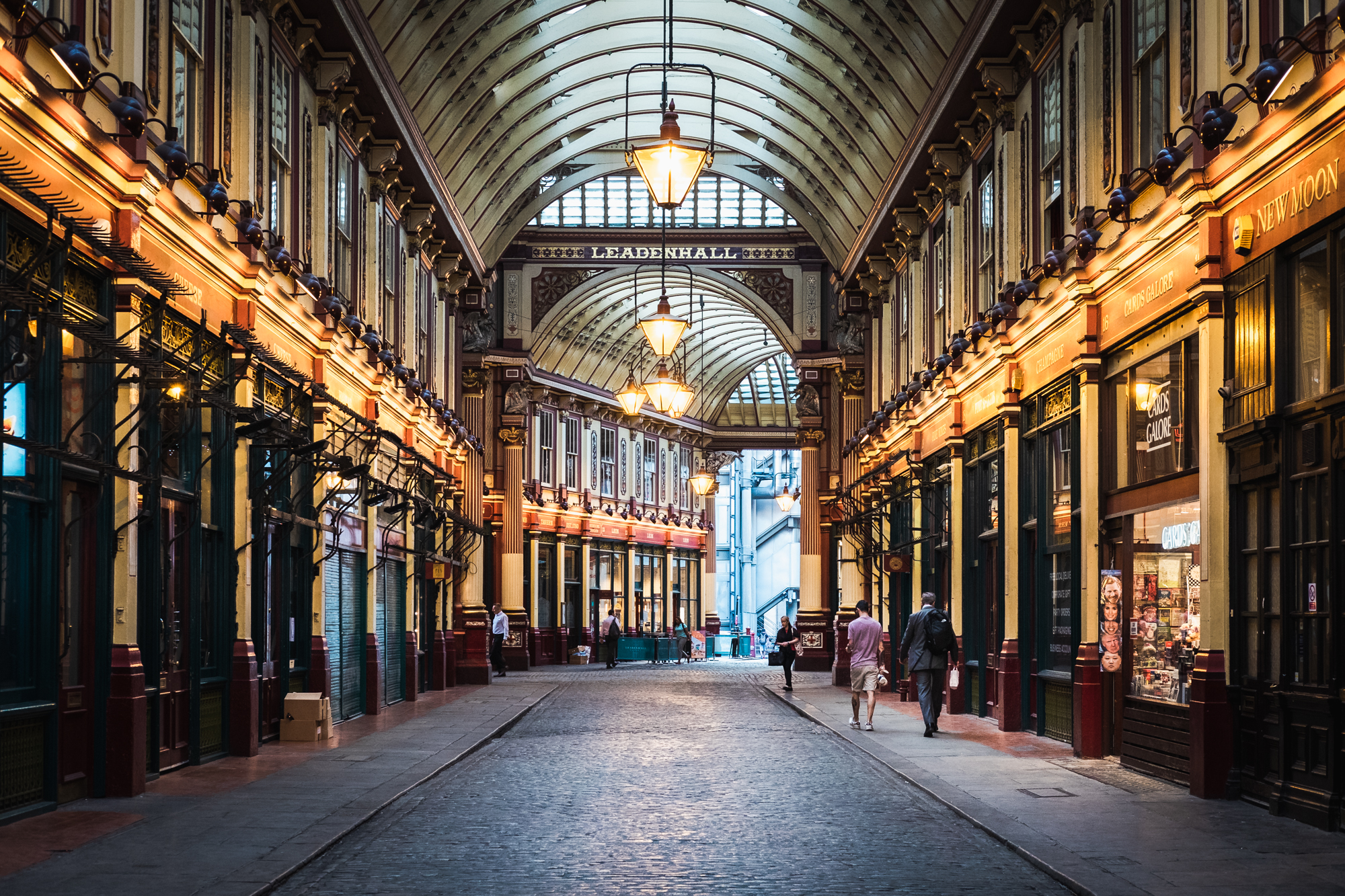 Architecture and street photo of people walking through Leadenhall Market, London by Trevor Sherwin