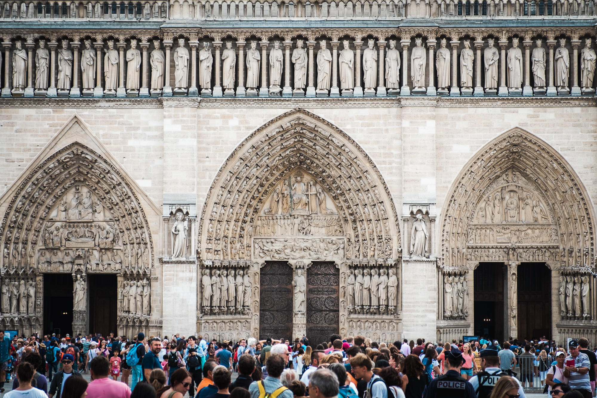 Entrance to Notre-Dame | Fujifilm XT2 | XF18-55mm | 55mm | 1/600 second | f/4 | ISO200