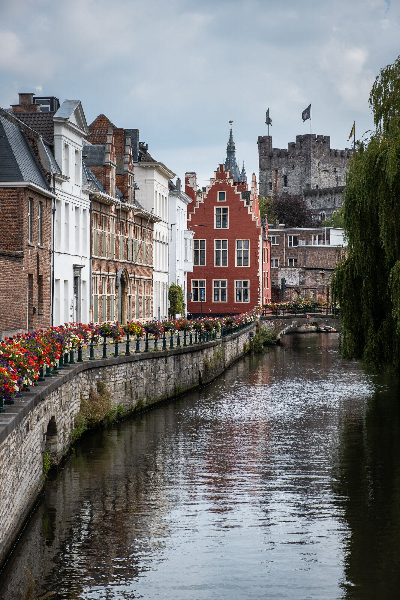 A view of Gravensteen Medieval Castle along the river