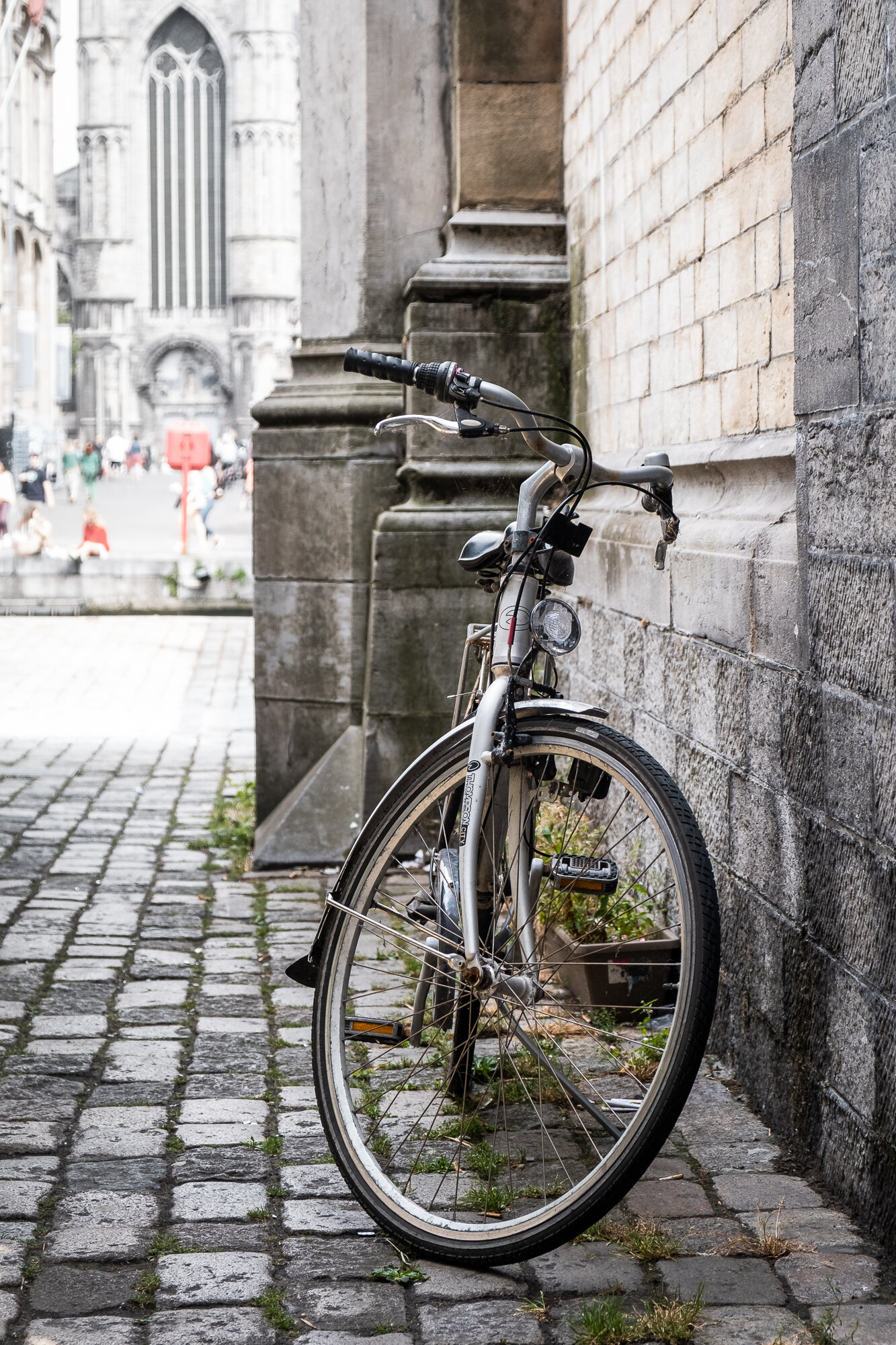 A bike leaning against Saint Michael's Bridge