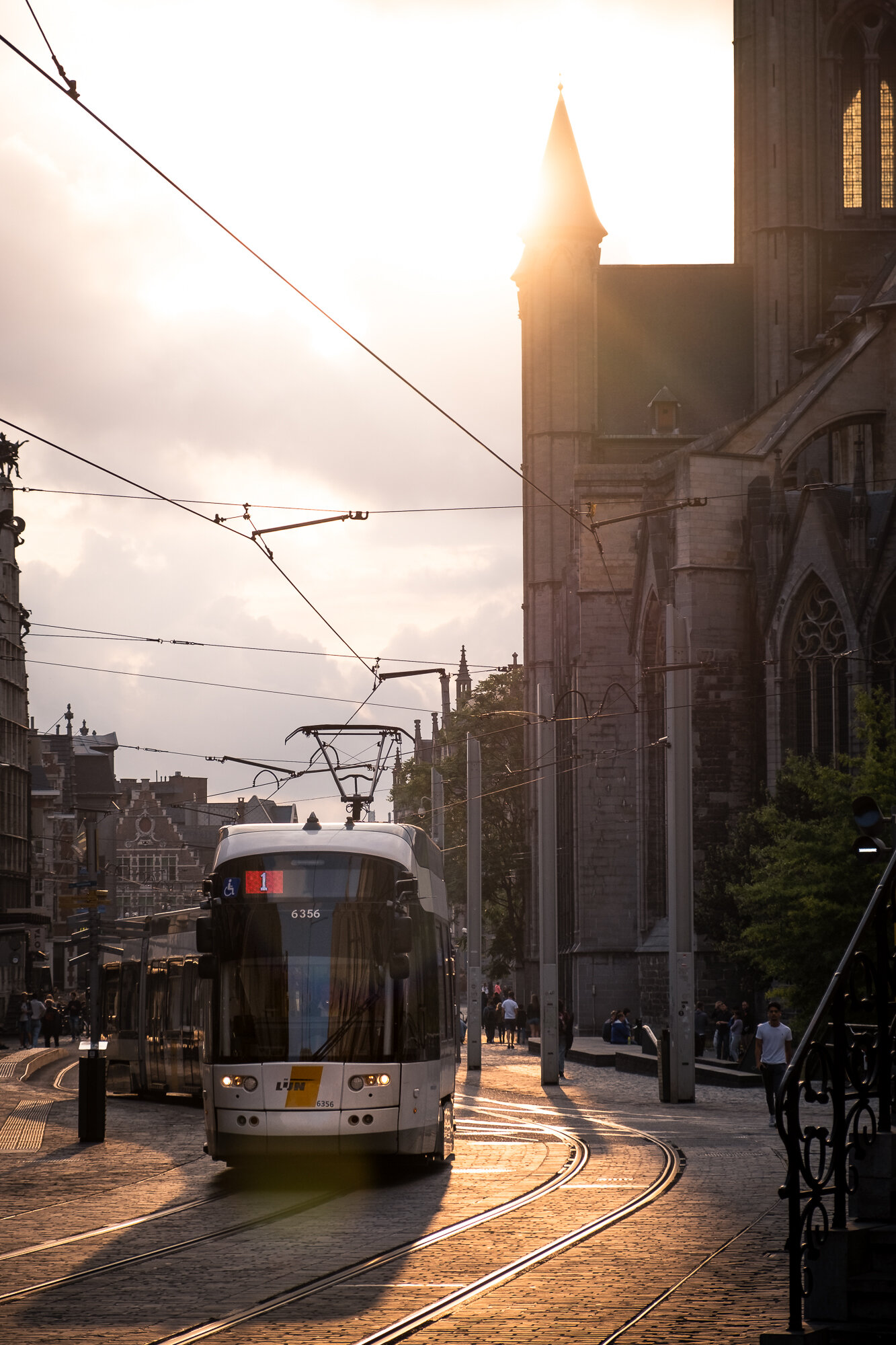 A tram driving through the city streets