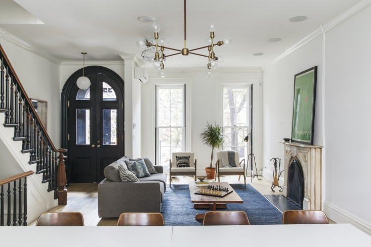 """- CHALLENGE With dimensions of 14' wide and 20' long, the entry way opens to the living room leading to the dining room, kitchen and outside.SOLUTION Define that """"hallway space"""" with your fabulous couch creating a cozy social area."""