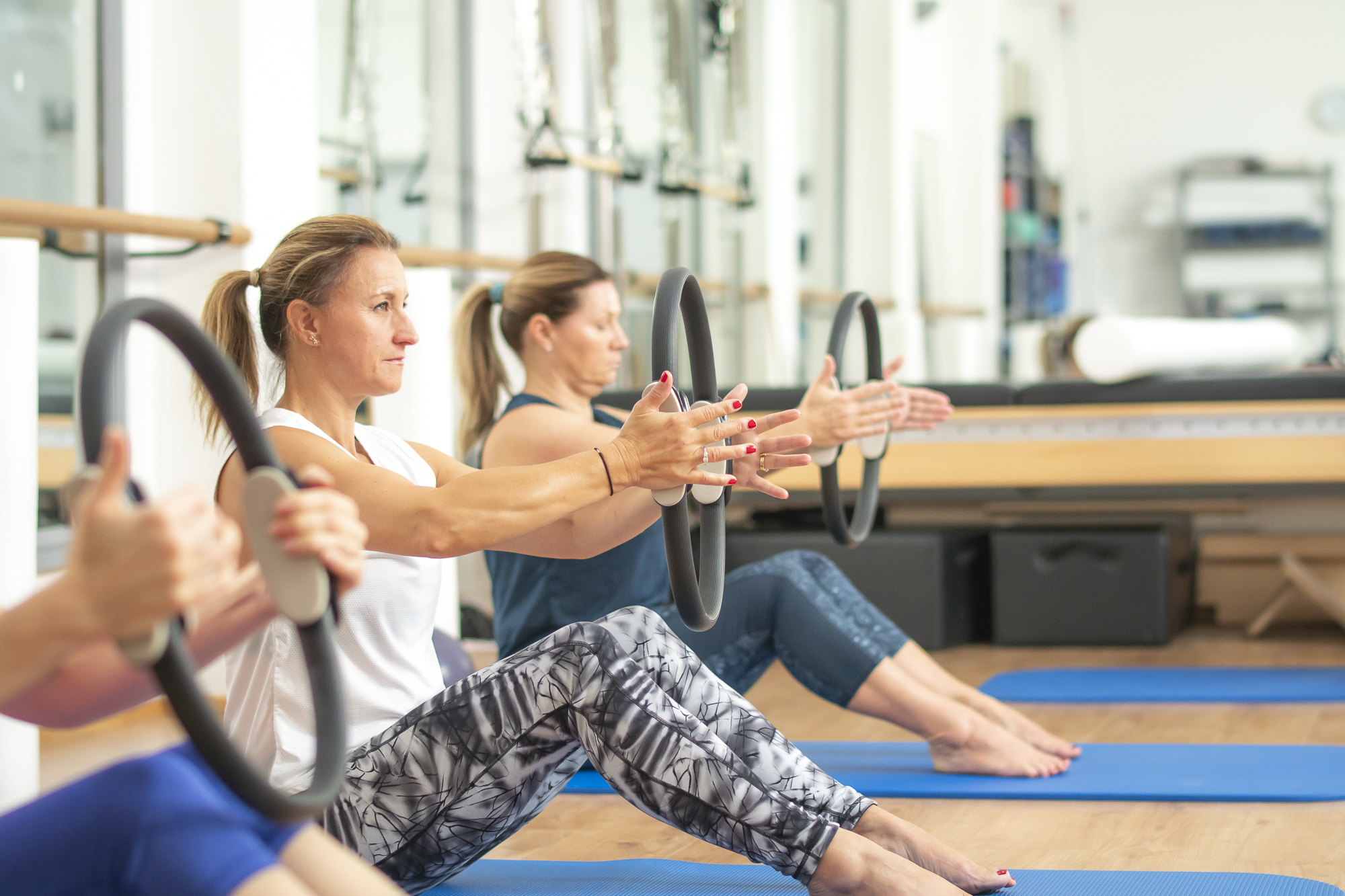 Group Pilates class using the Pilates magic circle. Based in a studio in Thames Ditton, Surrey.