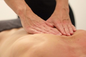 Soft tissue massage therapy to alleviate aches and pains, neck and back ache.