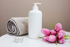 Massage oils, towels and a calming environment for massage