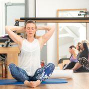Pilates teacher in Surrey teaching a Pilates class