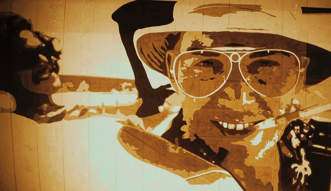 FEAR AND LOATHING   Size:  2 ft X 3 ft   Medium:  Brown Tape on clear plexiglass with custom lightbox frame.