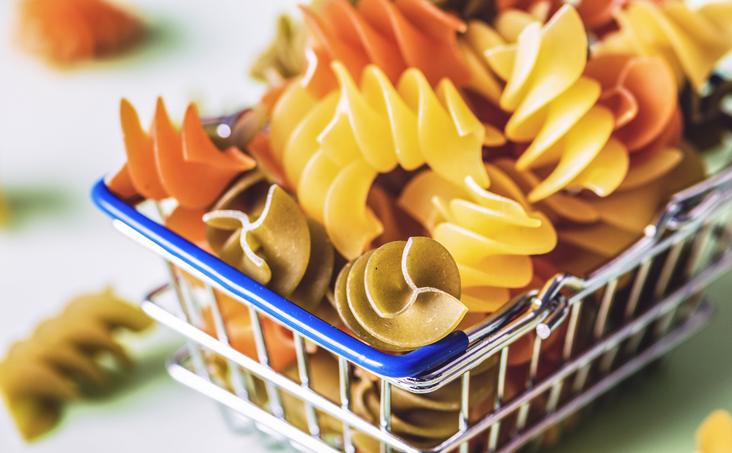 grocery cart basket with noodles