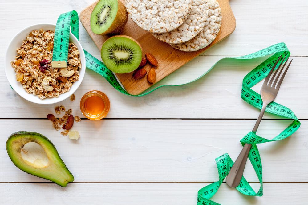 Healthy food with muesli, honey, kiwi and cereals