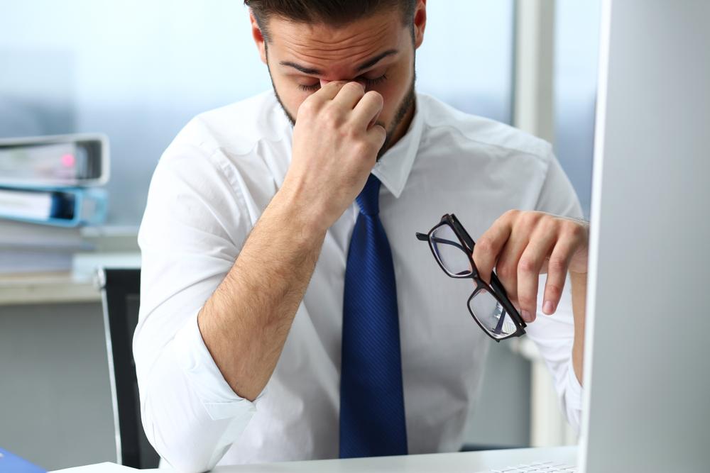 stressed man in an office.jpg
