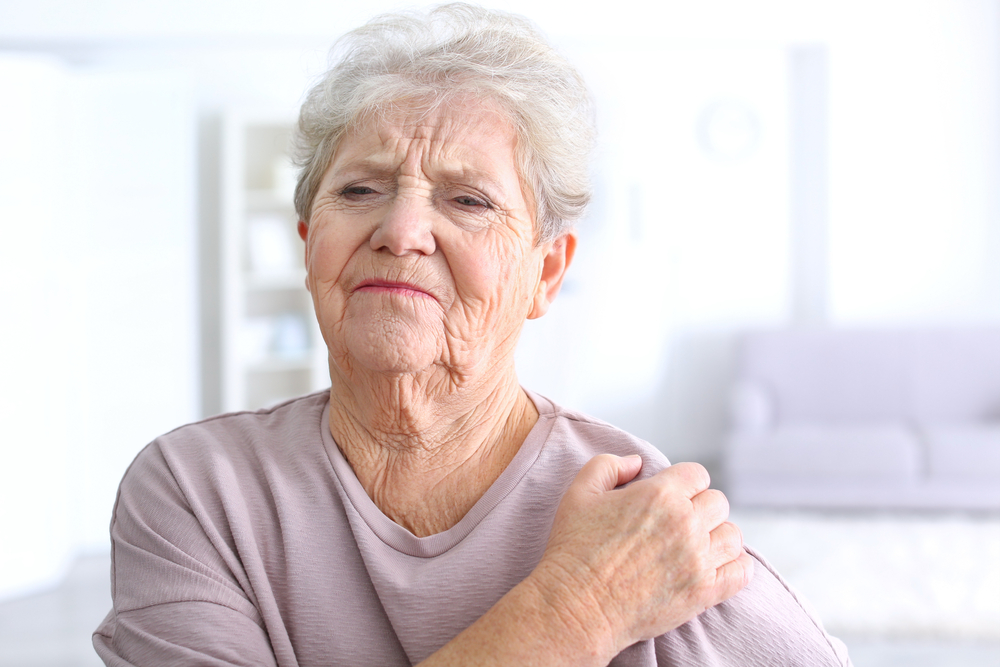 woman suffering from shoulder arthritis
