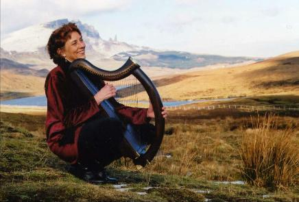 Nancy with her clairseach on the Isle of Skye