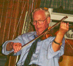 Buddy MacMaster playing at a Ceili in Glencoe Mills Hall, 2003
