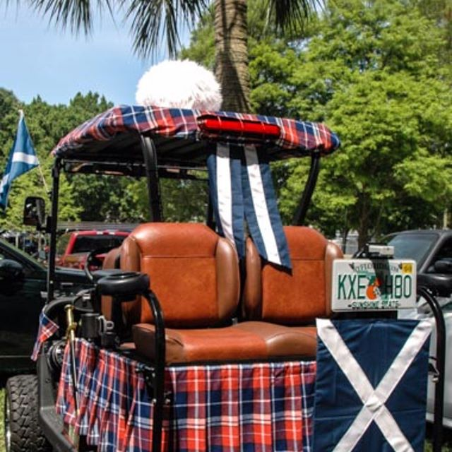 Tartan golf cart at the Dunedin, Florida Highland Games. Try carting this around St. Andrews - or through the Cairngorms on a sunny day!