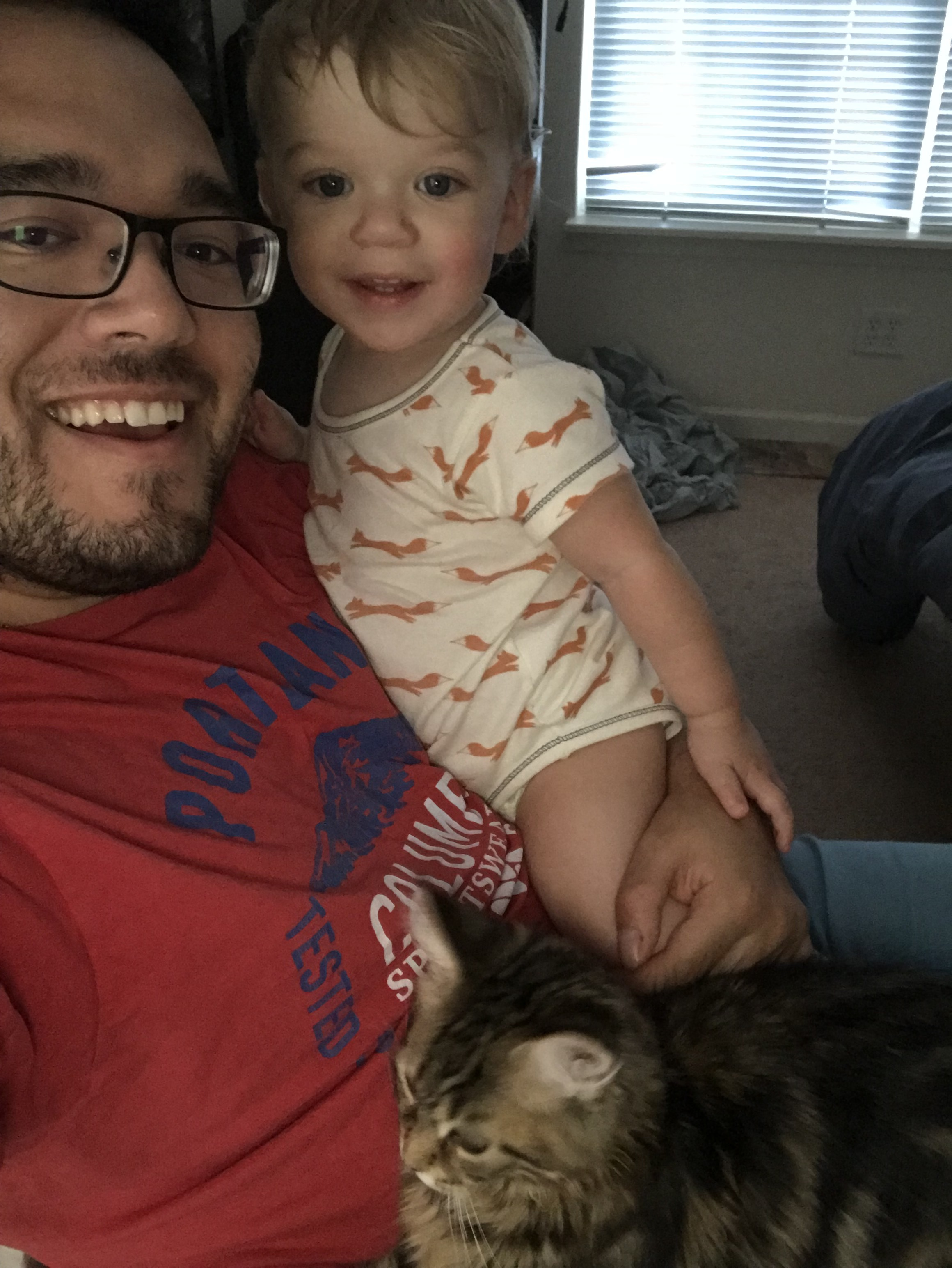 "Ries flexing his ""stay at home dad"" muscles later in the summer, juggling a one year old and Maine Coon cat. (July 2018)"