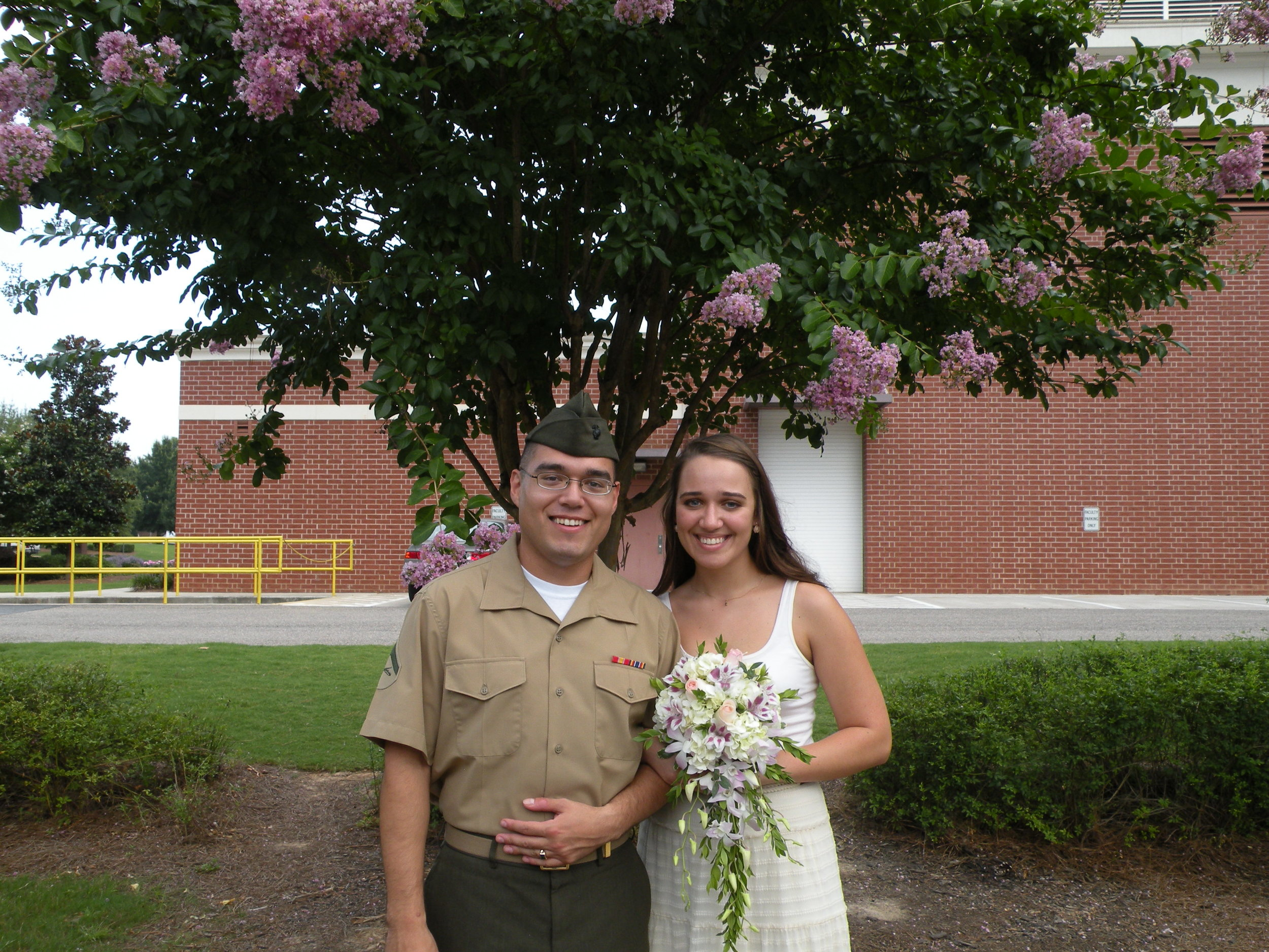 26 July 2013, Columbia County Courthouse. A photo from our legal marriage. We got married with four other couples and one of them let everyone borrow her flowers. Not glamorous, but we were so happy.
