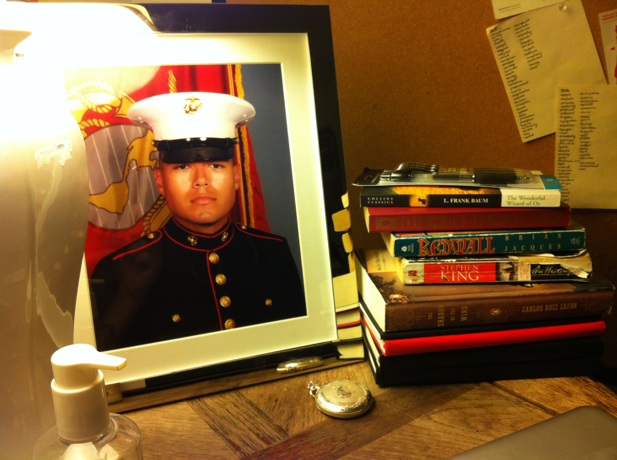May 2013, Greencastle, Indiana. This was my bedside table before I moved down to Georgia. It was filled with things that reminded me of Ries—his watch, his portrait, and some of his favorite books.