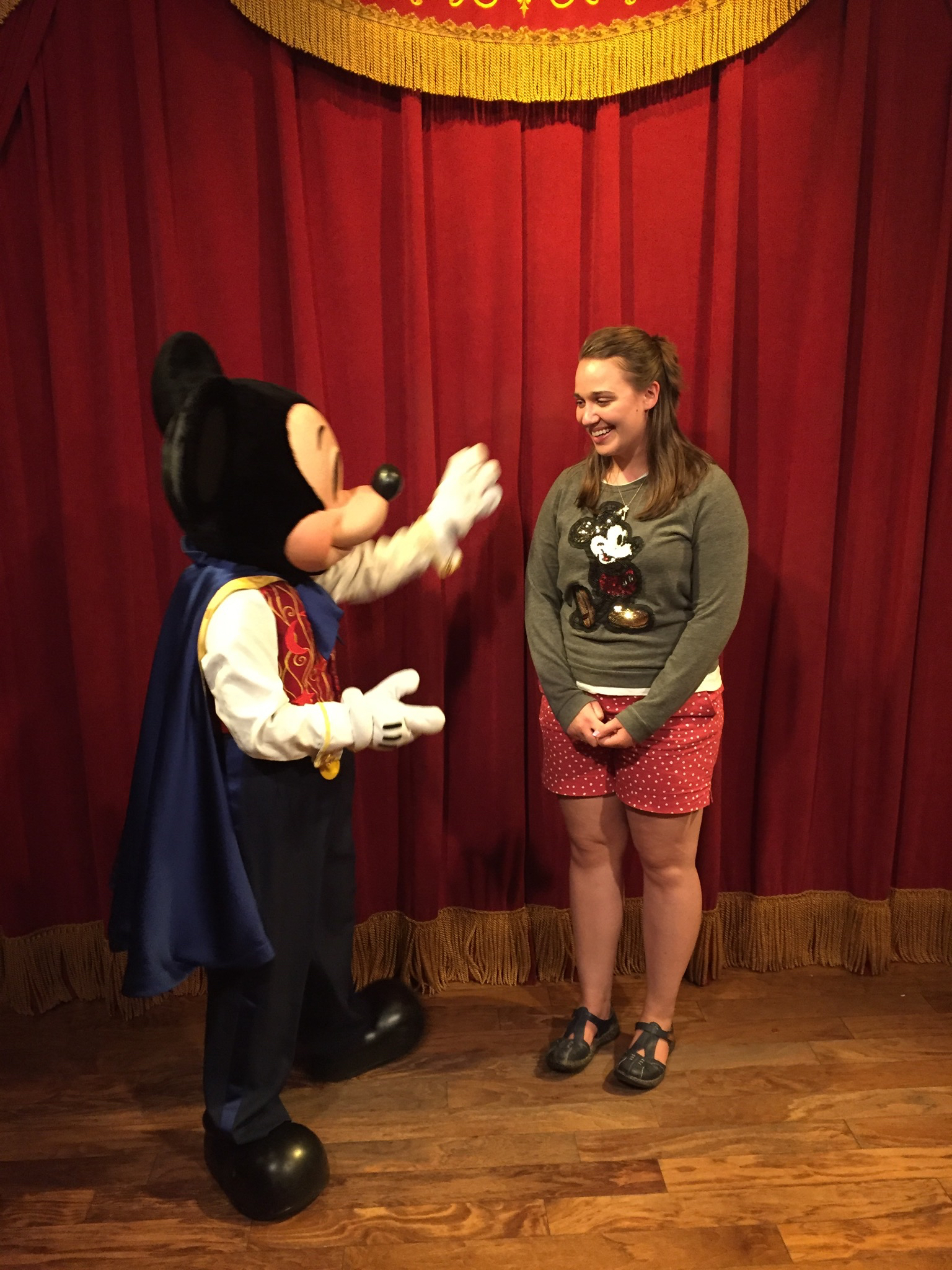 My first time meeting Mickey in Magic Kingdom.