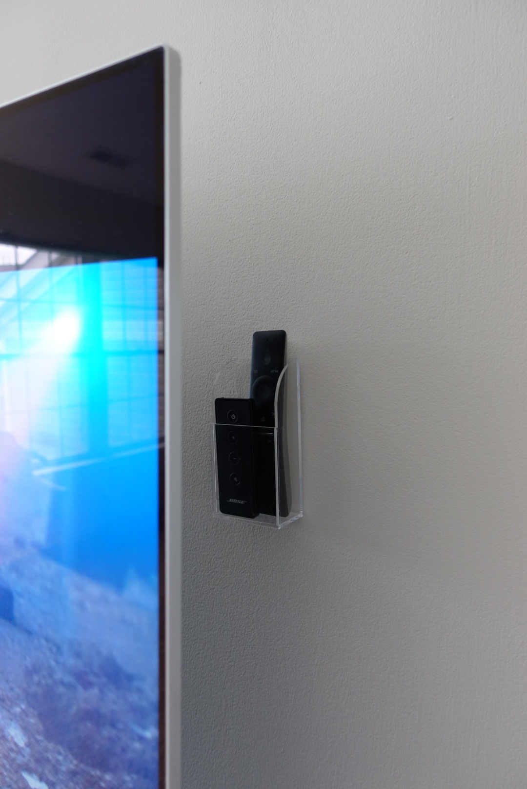 Our remote storage container is behind our television so you can't see it when viewing the TV from the front.