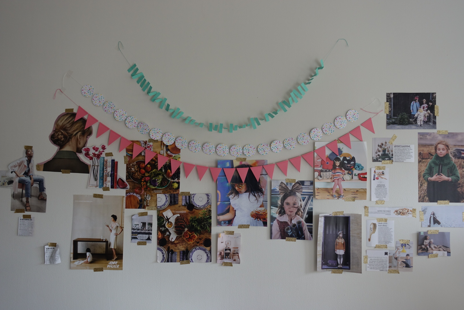 My inspiration wall, decorated with magazine clippings and party garlands from Target.