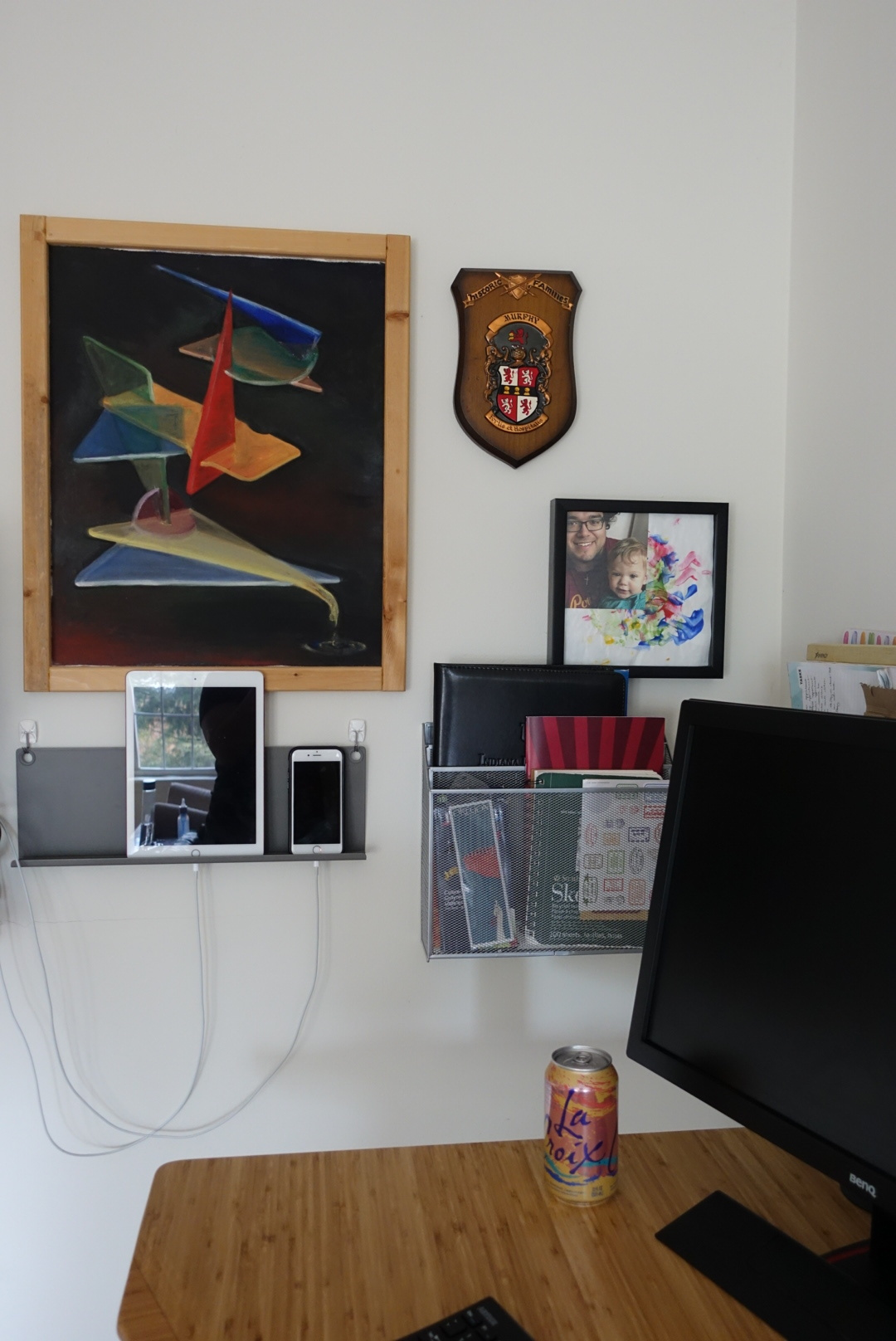 Our desk area includes A LOT of mounted storage, as well as a charging station on the wall.