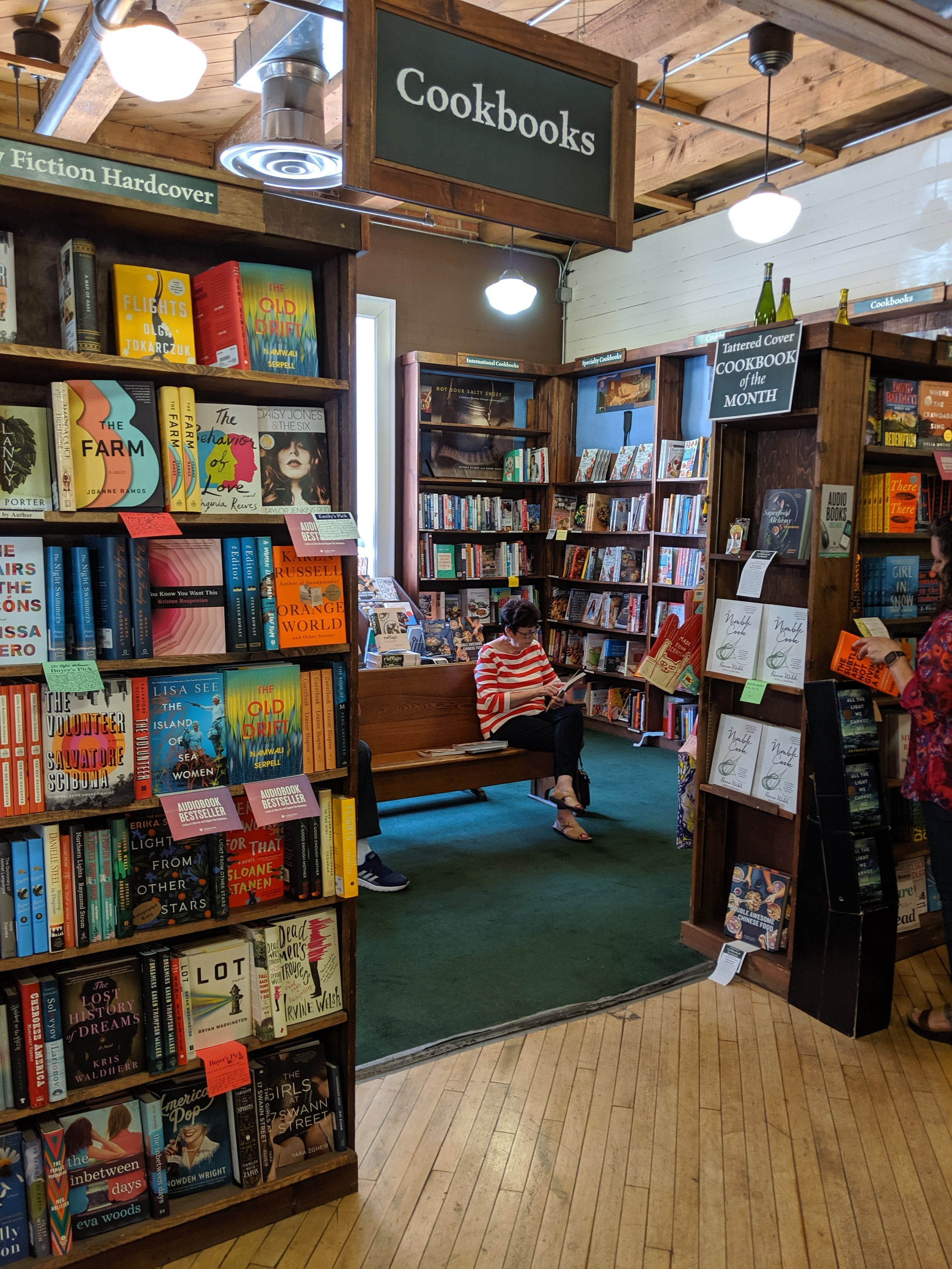 One of my favorite parts of Tattered Cover were the pews in the store for book lovers to sit down and check out the books.