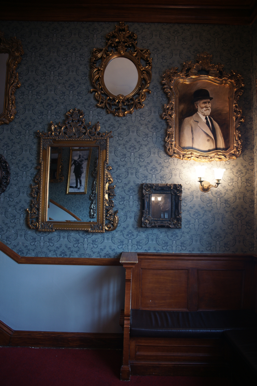 Portraits and mirrors in The Vortex, The Stanley Hotel, Estes Park, Colorado.