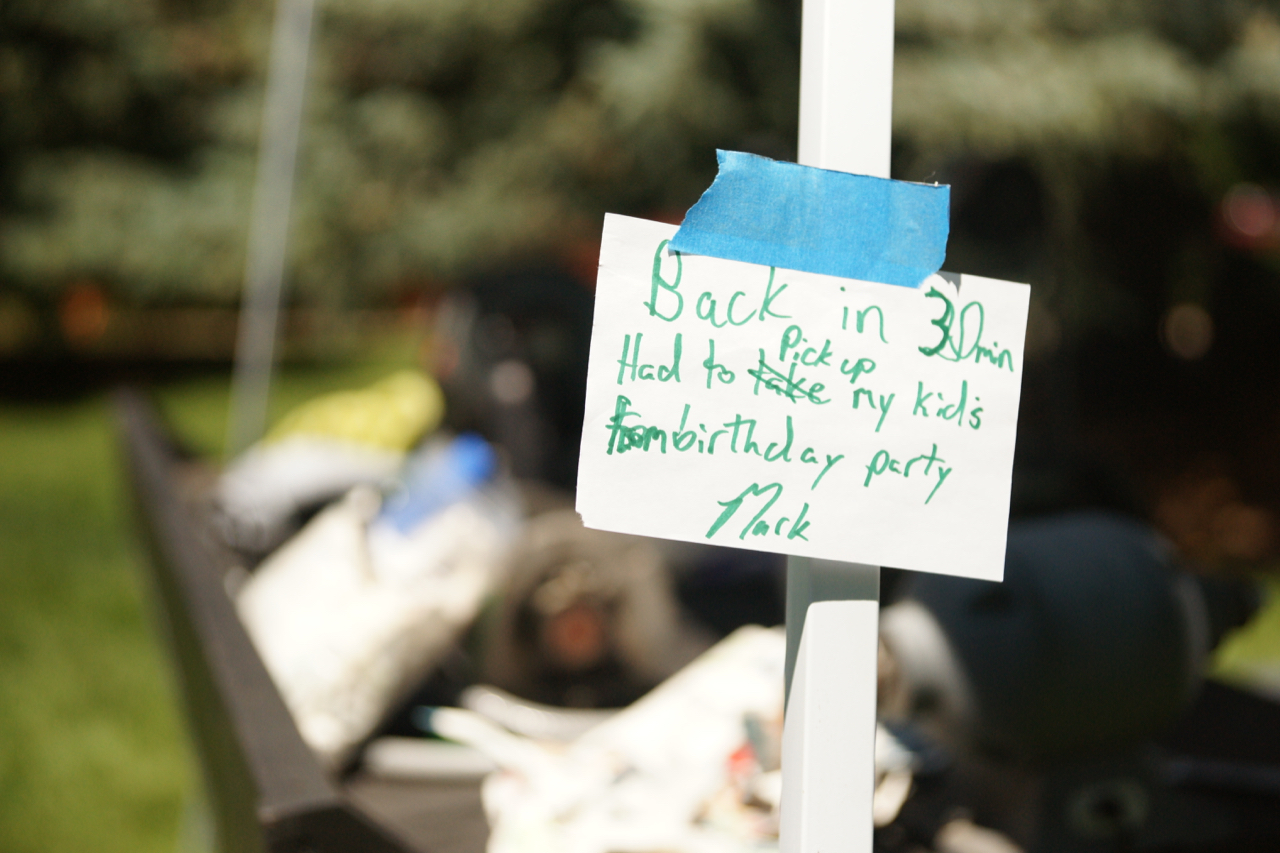 A sign at the knife sharpening booth at the Berthoud, Colorado Farmers' Market.