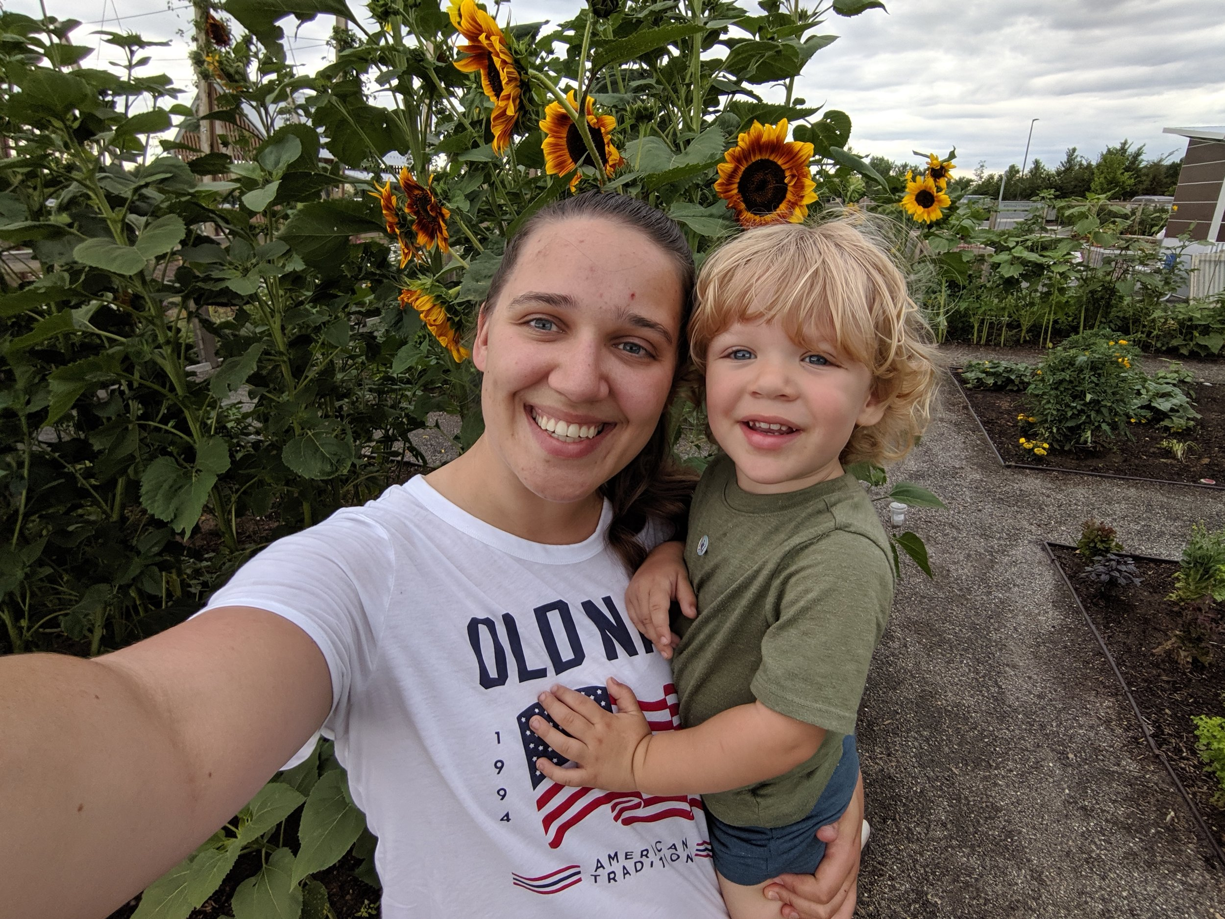 Gus and I snuck into the Community Garden at Twin Silo park in Fort Collins, Colorado to take photos with the sunflowers.