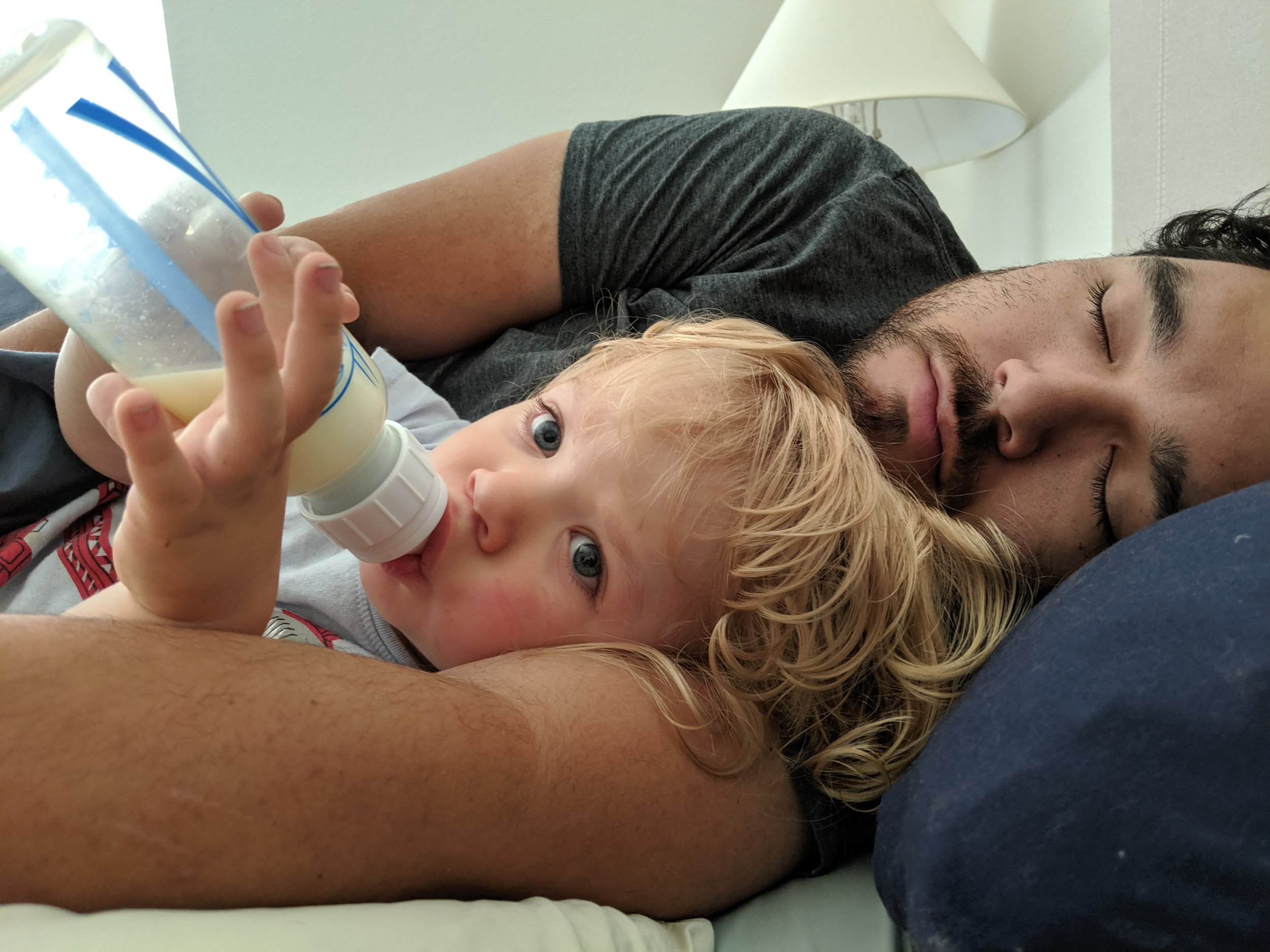 Gus waking up with his Daddy on Ries' last day at his HPE internship.