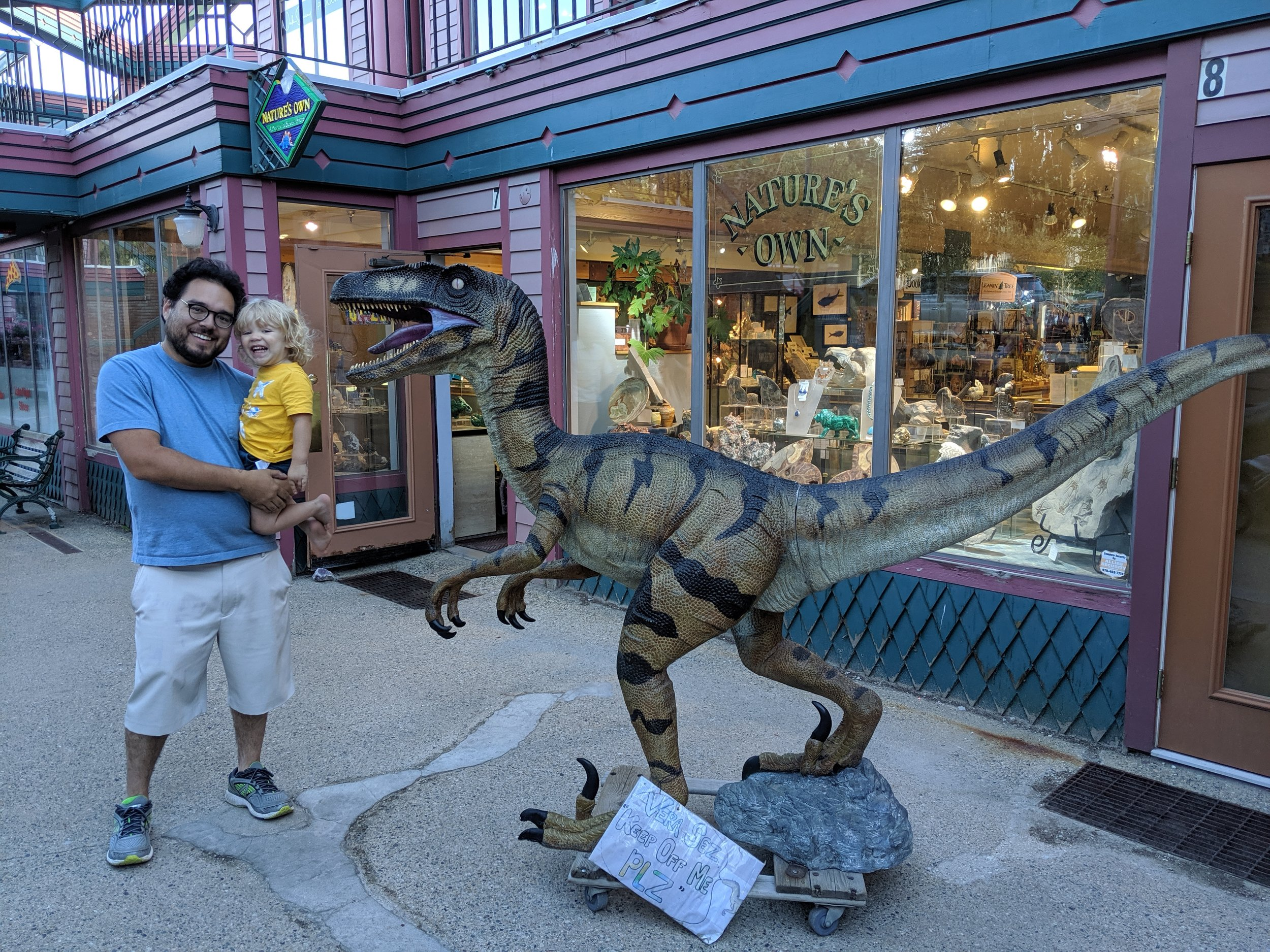 """Ries and Gus with """"Rawkey"""" outside Nature's Own in Breckenridge, Colorado."""