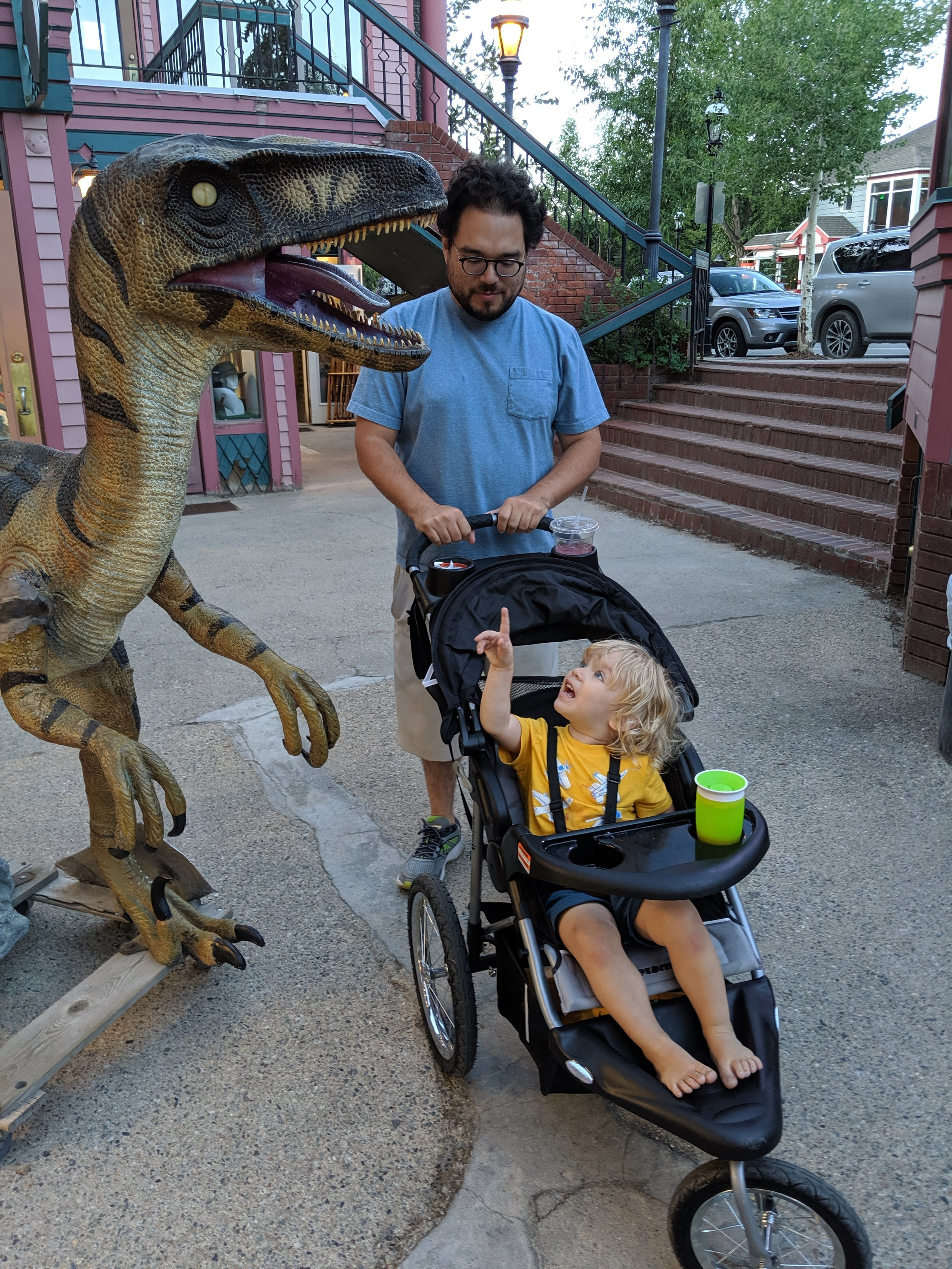 Gus saying goodbye to a dinosaur outside Nature's Own in Breckenridge, Colorado.
