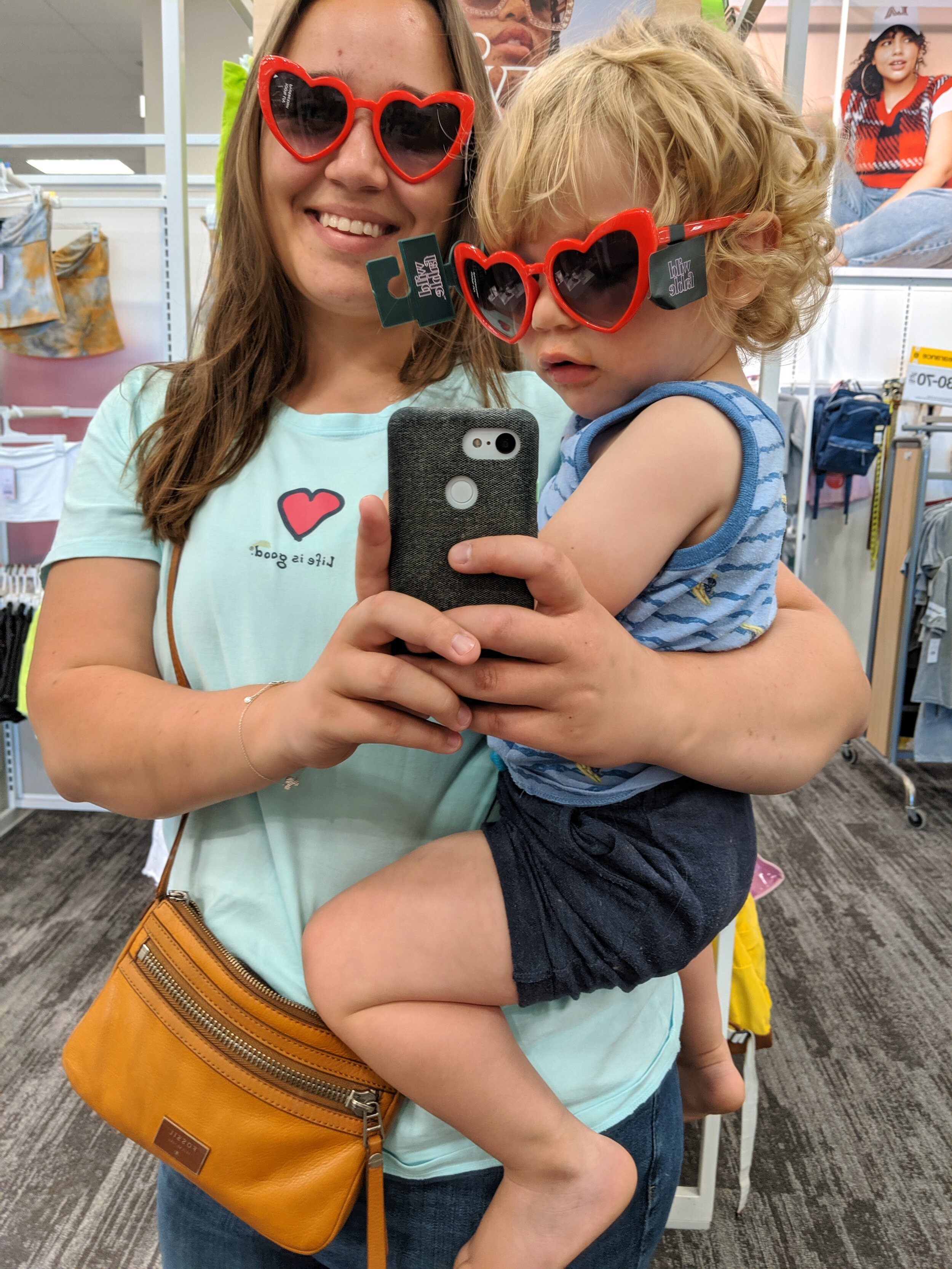 Little Bud on the day he picked out matching sunglasses for us.