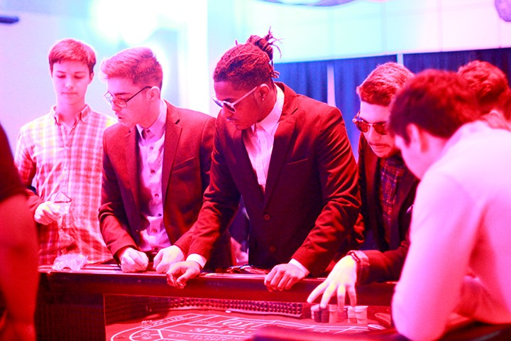 Students fittingly adopt a high roller style at Casino Night Saturday evening. Photo by Meghan Schiereck.