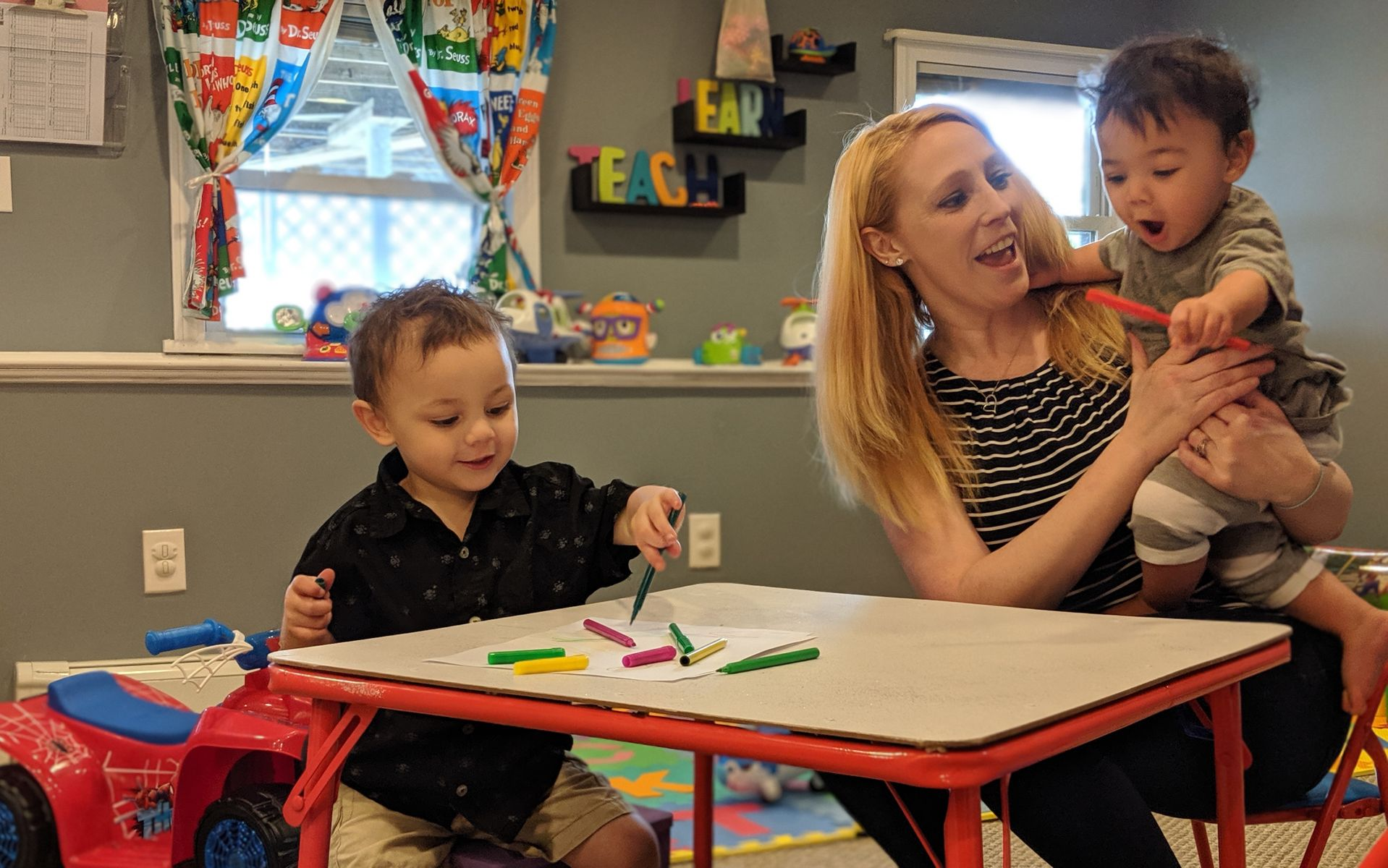 Ms. Jennifer in her creatively designed and brightly lit new home daycare in Haverhill, MA.