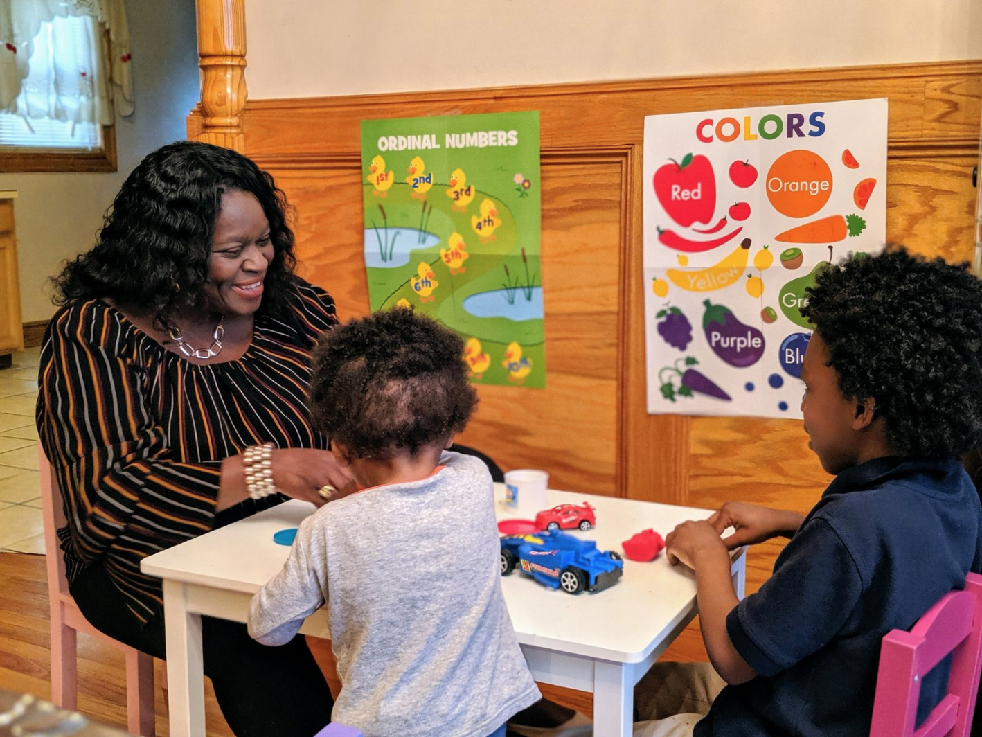 Geralyn Fagan plays with children at the new BabyAnne's Early Childhood in Dorchester.