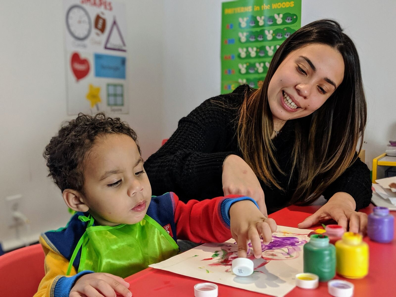 Ms. Valeria plays with a child at her home daycare in Mattapan, MA.