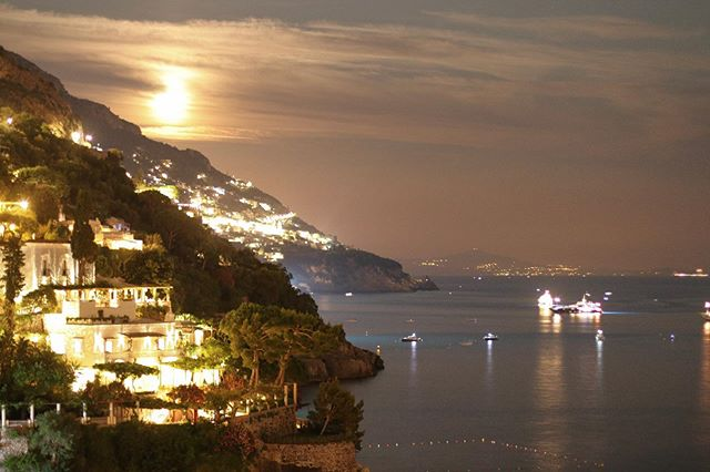 The beautiful Amalfi posing tonight with the moon🌙 Loving these long days of sunshine💫 views from @lafenicepositano are the best!