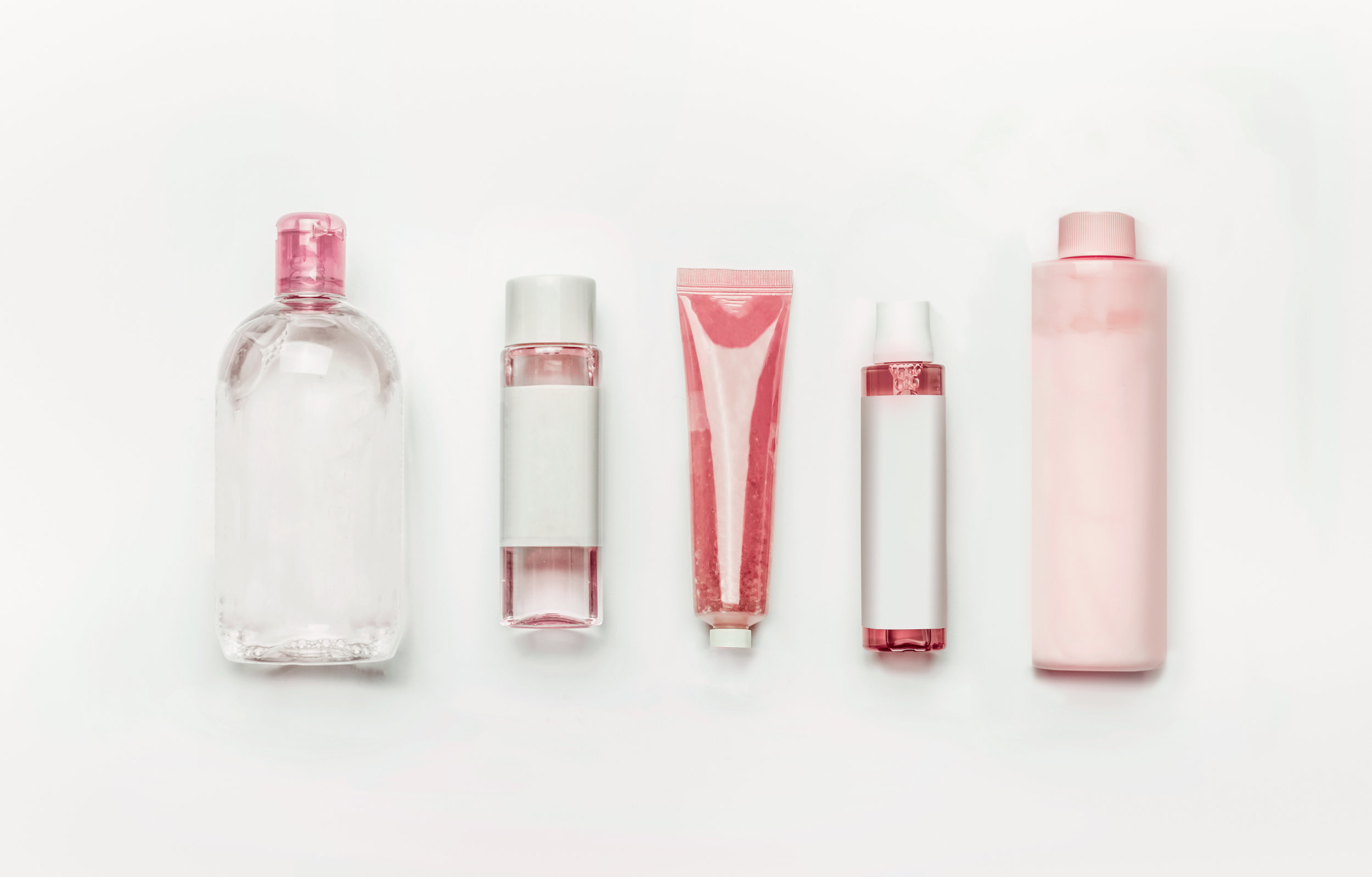 stock-photo-pink-natural-cosmetic-products-gel-lotion-serum-micellar-water-and-toner-bottles-and-tubes-1074149759.jpg