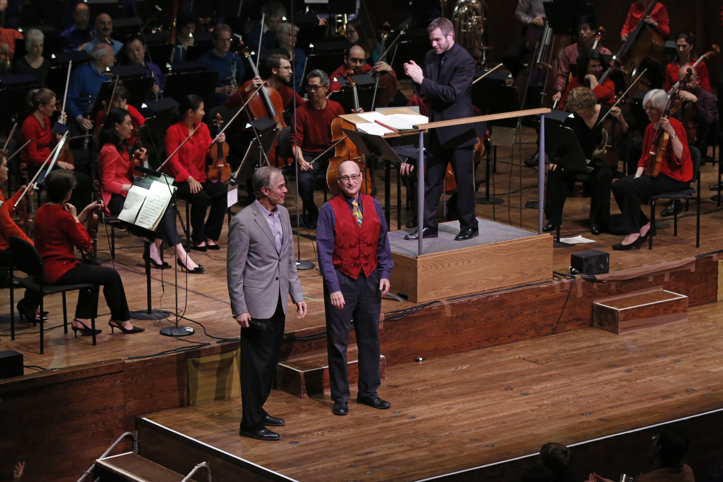 """New York Philharmonic, Joshua Gersen conducting,  World Premiere of excerpts from the new version for orchestra of Raphael Mostel's """"Babar's Honeymoon""""   Raphael Mostel with New York Philharmonic director of education, Theodore Wiprud  photo: Michael DiVito"""