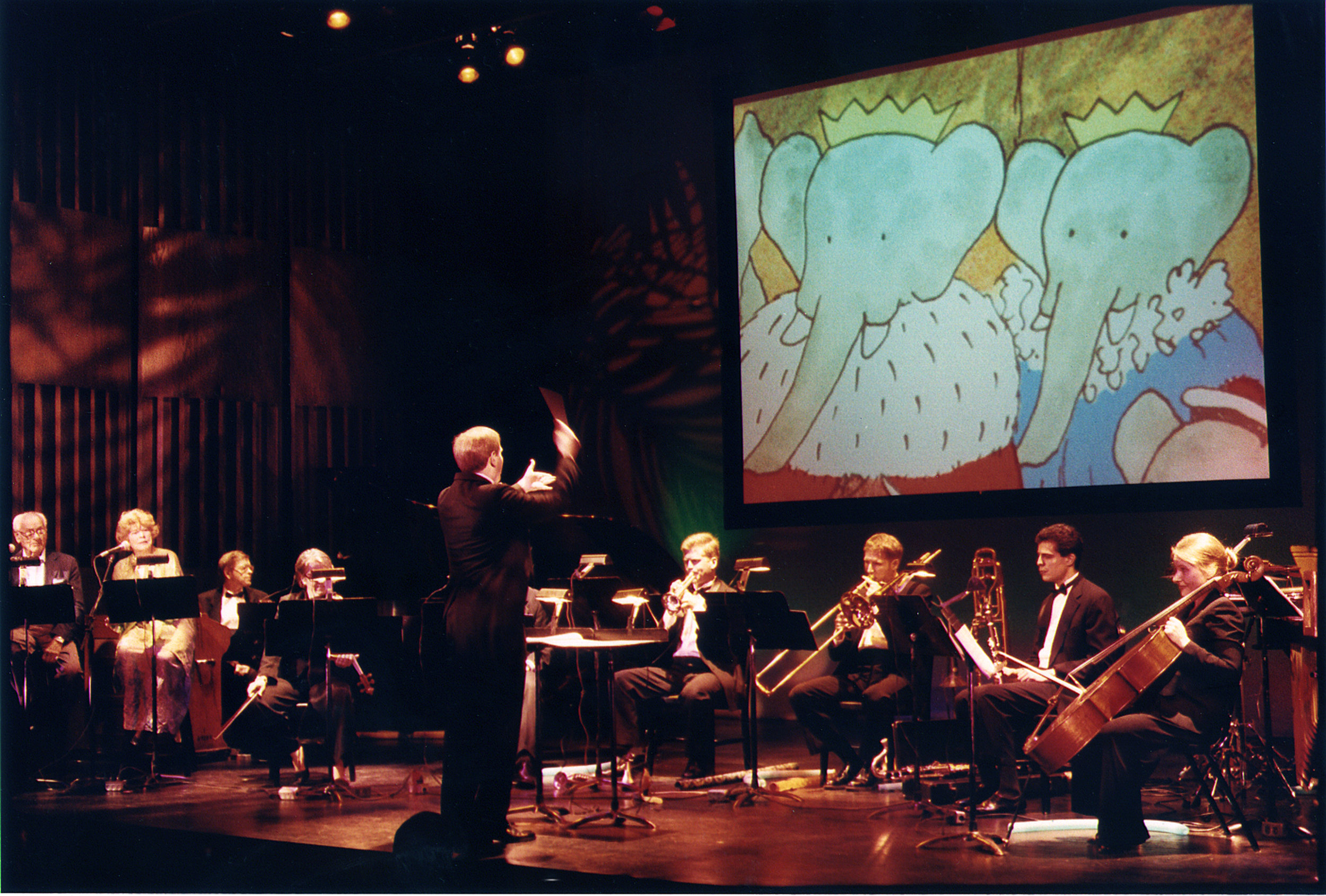 Narrators Eli Wallach & Anne Jackson, first Source Music, Inc. presetation of prior, non-HD, full Florence Gould Foundation production of Raphael Mostel's  Travels of Babar , with lighting by Michael Mazzola, Paul Hostetter conducting  photo: Hiroyuki Ito