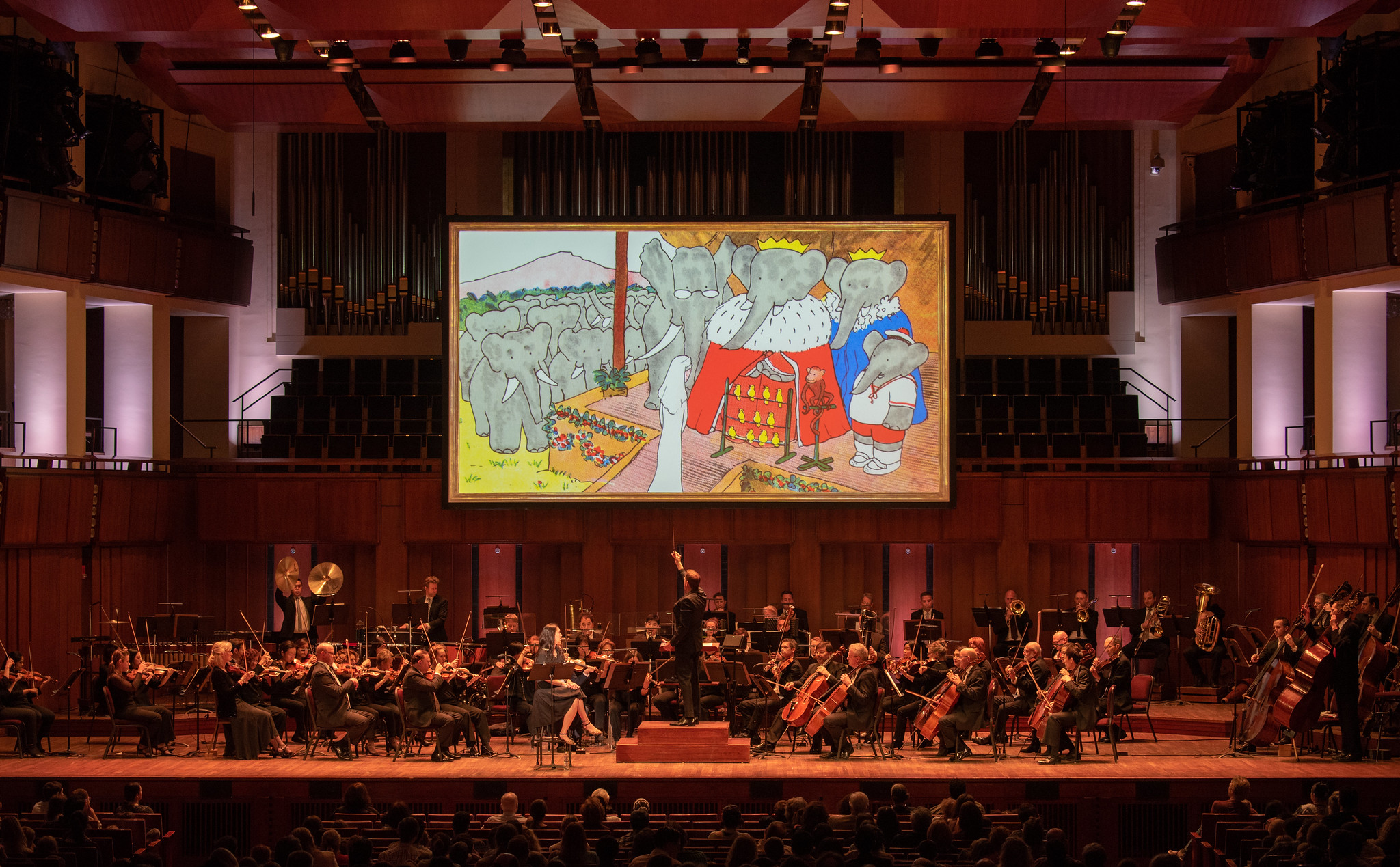 First U.S. performance, Raphael Mostel / Jean de Brunhoff   Babar's Return to the Land of the Elephants   for orchestra,  Royal Ceremony  scene  National Symphony Orchestra, Steven Reineke, conductor, Regina Aquino, narrator, John F Kennedy Center for the Arts, Washington, D.C., April 7, 2019  Photo: Erica Bruce, for Mostel.com (full size photo available). Used with permissions