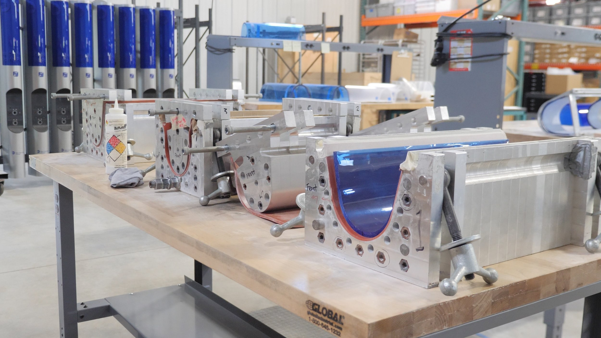 Custom molds fabricated at Boyce are used to form the sheets of blue polymer into just the right shape.