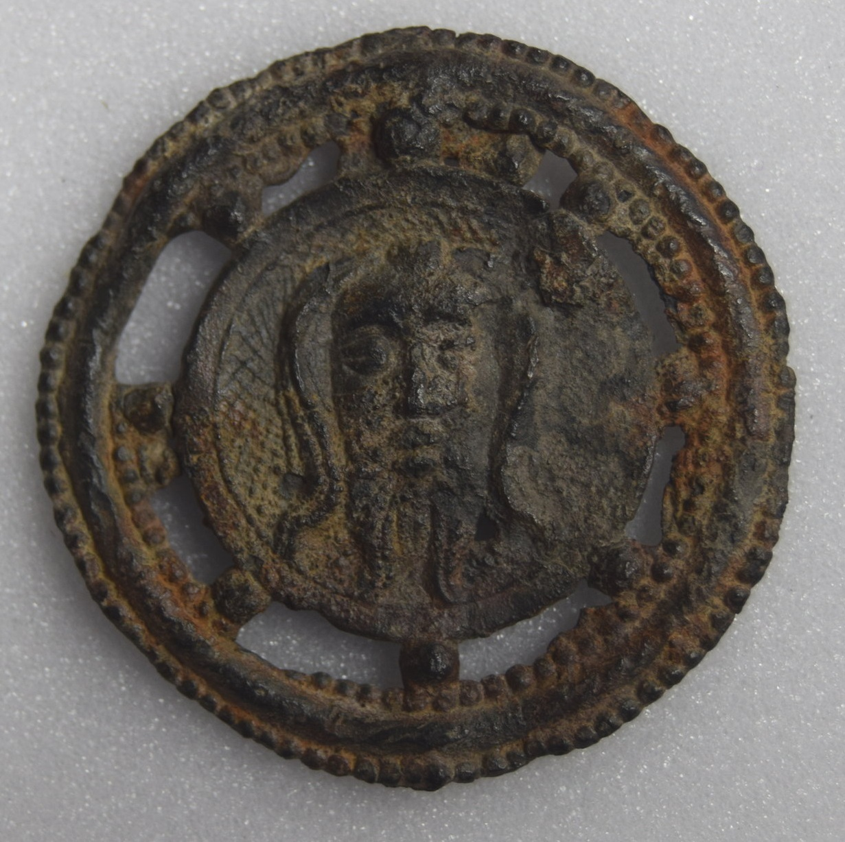 Tin Lead Alloy, Veronica Icon: countenance of Christ on a veil, surrounded by dots in round frame, Rome, 1000-1599, 310 x 400 mm. King's Lynn, Lynn Museum, PB 49 (Kunera 07520). Photo courtesy of Shannon Phaneuf.