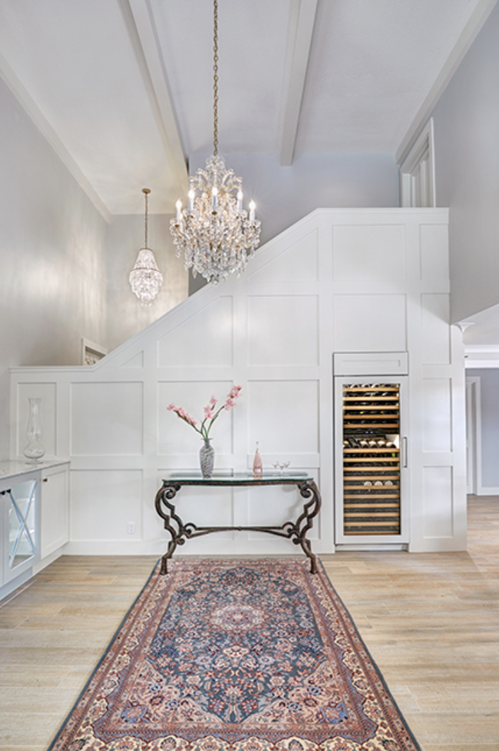 Ornate decor pops against the sleekly modern floors and woodwork of this space. Designer: Nar Design Group; Photographer: Fred Donham of PhotographerLink