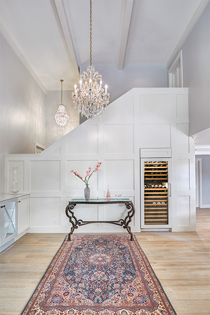 Photo, above: Ornate decor pops against the sleekly modern floors and woodwork of this space. Designer: Nar Design Group; Photographer: Fred Donham