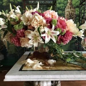 With the extreme heat of the day, this gorgeous bouquet in Ken Fulk's magical dining room was succumbing, petal by petal, to exquisite decay.