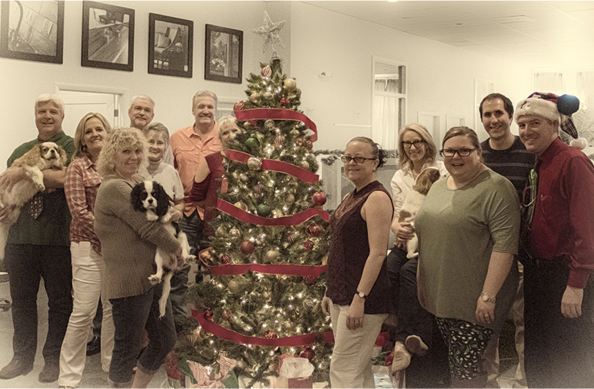 The Tampa Bay area Steelies pause to celebrate the 2017 Holiday season with an office family selfie around the tree.   From left to right: Shawn Hughes (holding Derby),    Ava Macias,       Kathy Rocchio    (holding Maisy) Ken Evans,    Joanne Forsythe   , John Hecker, [half of]    Lynn Molter   ,    Kristy Cuttita   , Sandy Hughes (holding Audrey Hepburn)    Jamie Blomkvist   , Michael D'Imperio, and    Brian Parks   . Photo by Brian Parks.